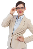 Smiling young businesswoman holding her glasses