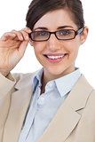 Cheerful businesswoman holding her glasses