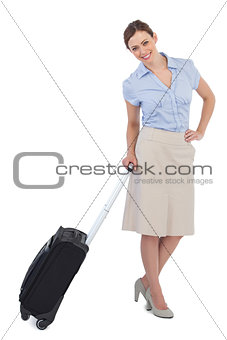 Cheerful classy businesswoman carrying suitcase