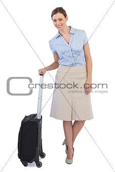 Elegant businesswoman posing with suitcase