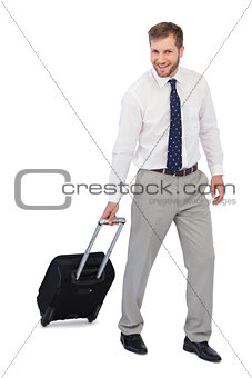Cheerful businessman with suitcase