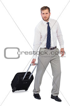 Serious businessman with suitcase