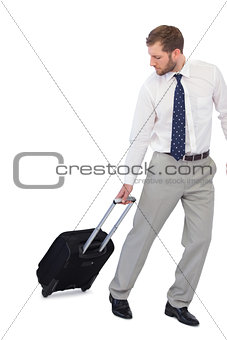 Annoyed businessman with suitcase