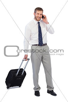 Cheerful businessman answering phone