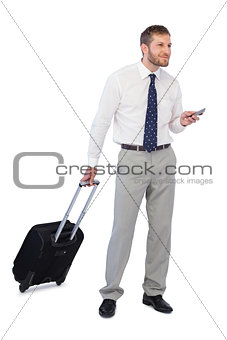 Thoughtful businessman holding phone