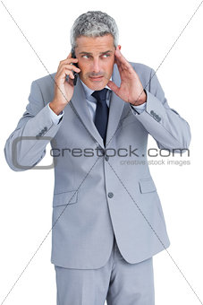Attentive businessman answering phone