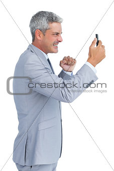 Angry businessman answering phone