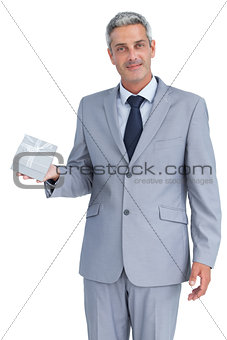 Attractive businessman holding gift