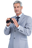 Businessman posing with binoculars
