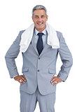 Sporty businessman with towel