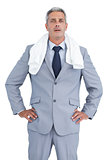 Sporty businessman with white towel