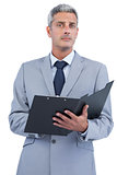 Self assured businessman with clipboard