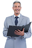 Cheerful businessman holding clipboard