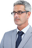 Thoughtful businessman wearing glasses