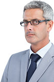 Severe businessman wearing glasses