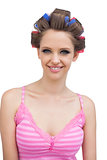Smiling model with hair curlers