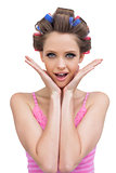 Cheerful young model with hair curlers