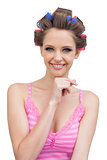 Happy young woman with hair curlers