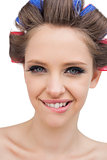 Cheerful model with hair curlers