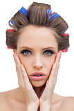 Sensual model with hair curlers