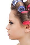 Profile of young model with hair curlers
