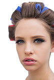 Model with hair curlers in close up