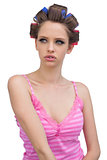 Sensual young model in hair curlers posing