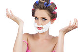 Questioning woman with shaving foam on face
