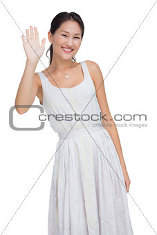 Welcoming woman smiling and waving