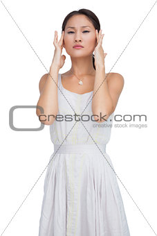 Concerned woman posing and looking at camera