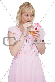 Attractive blonde drinking cocktail