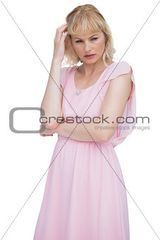 Thoughtful blonde woman touching her hair