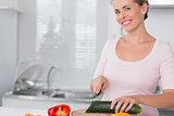 Pretty woman cutting vegetables