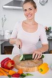 Smiling woman cooking