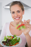 Smiling woman with salad dish