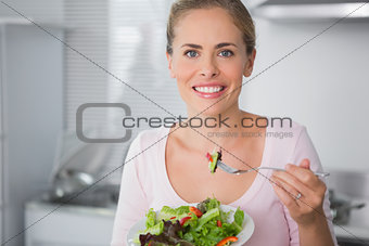 Attractive blonde with salad