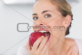 Attractive woman munching apple