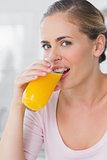 Pretty woman drinking orange juice