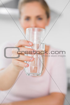 Blonde woman offering water