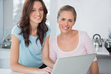 Cheerful women with laptop