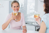 Cheerful women having glass of wine