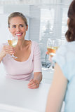 Radiant women having glass of wine