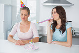Woman cheering up her upset friend on her 30th birthday