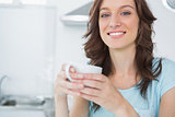 Radiant brunette drinking coffee