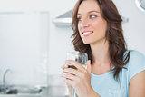Radiant brunette drinking white wine
