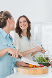 Pretty women preparing salad together