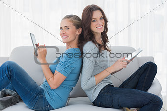 Cheerful women using tablet computer