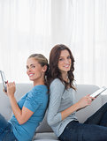 Cheerful women with tablet computer