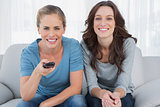 Cheerful women watching television