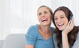 Cheerful women listening to music